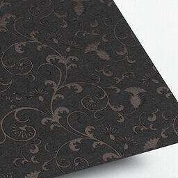 Black foil embossed onto uncoated black artboard.